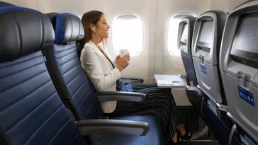 Woman sitting on an economy plus seat