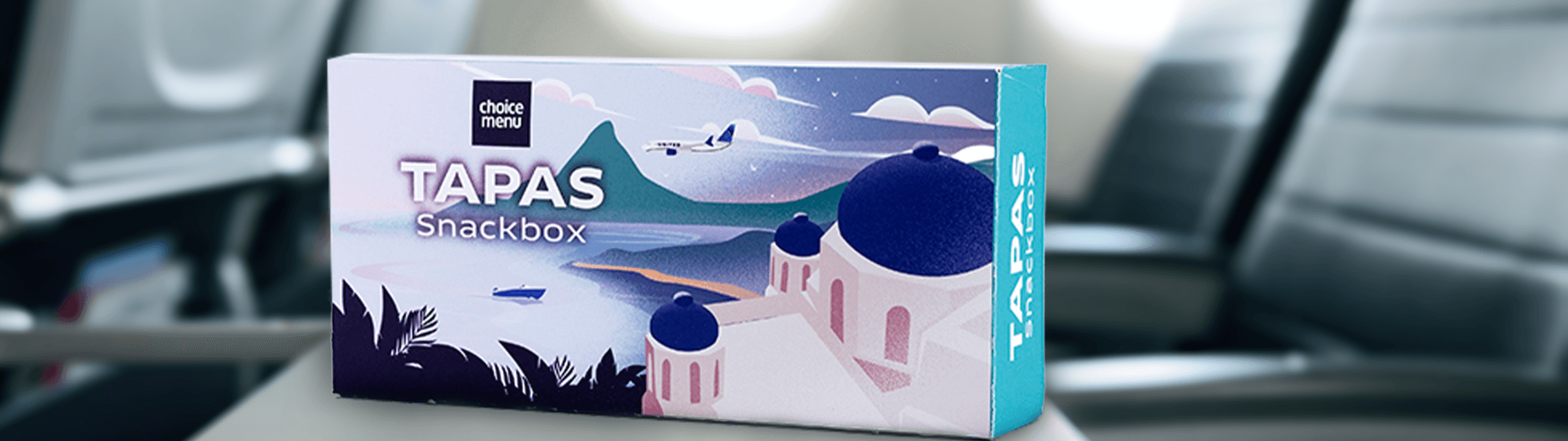 a representation of a Tapas Snackbox package sample shown on seat tray in flight.