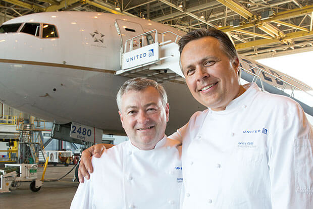 Chefs Gerry McLoughlin and Gerry Gulli in the foreground of a United aircraft